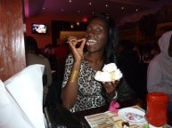 Birthday girl enjoying a complimentary cornbread cake in NYC!